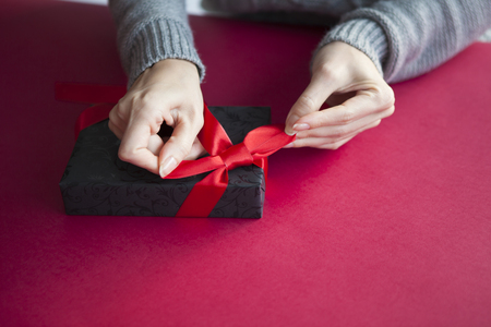 70943749 - a woman wrapping a gift box