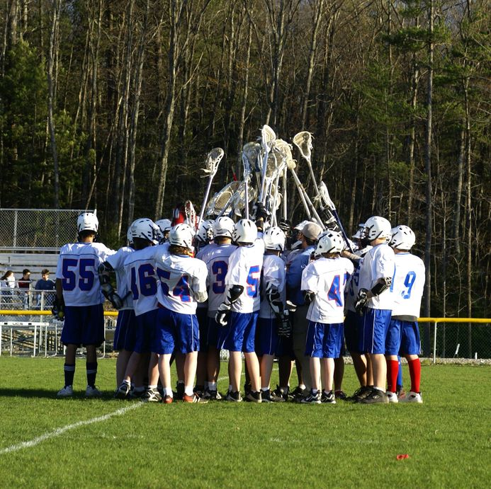 2876129 - a high school lacrosse team at a match